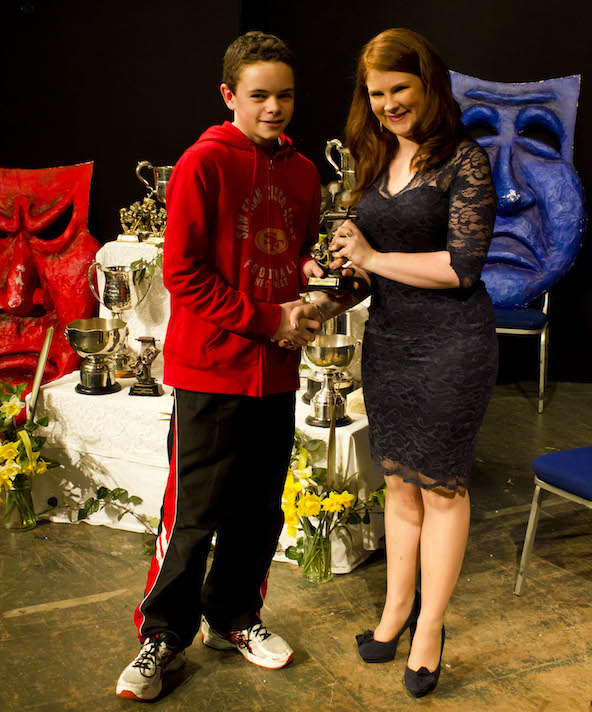 Sean McCarthy (13) from Skibbereen Theatre Society receiving a special adjudicator's award for his part in No Romance by Nancy Harris from Catherine Deasy, secretary of the West Cork Drama Festival.