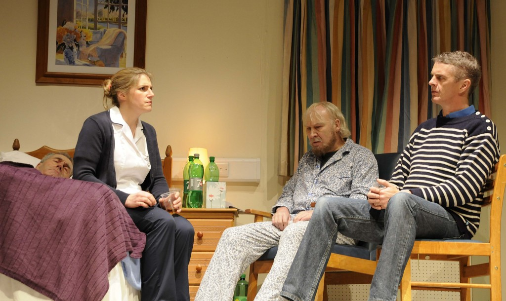 The cast of the Skibbereen Theatre Society production of 'The Quiet Moment' in pensive mood in a scene from the play by Mike Finn - from left - Fachtna O'Driscoll, Mary O'Driscoll, Gerry Minihane and Declan McCarthy. (Photo: Patricia Coogan-O'Dell)
